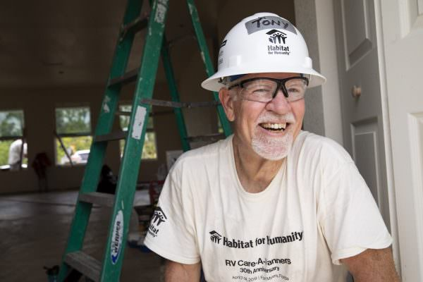 FORT MYERS, FL, USA (04/10/2019)-Tony Campbell lays flooring during the RV Care-A-Vanner 30th Anniversary build.  ©Habitat for Humanity International/Jason Asteros
