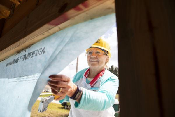 FORT MYERS, FL, USA (04/10/2019)-Penny Rusch works on house wrap during the RV Care-A-Vanner 30th Anniversary build. ©Habitat for Humanity International/Jason Asteros©Habitat for Humanity International/Jason Asteros